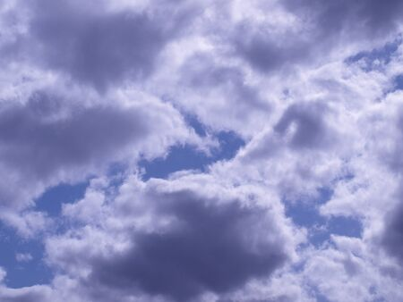 Beautiful fluffy white clouds, high in the sky above  Stock Photo