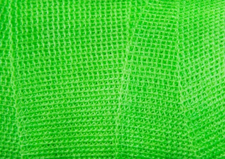 Green bandage use on a hard cast. Stock Photo