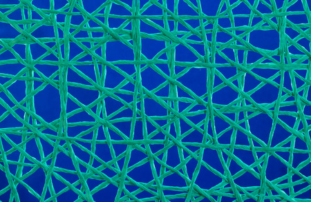 Green string crossing over each other to make a net or web. Stock Photo