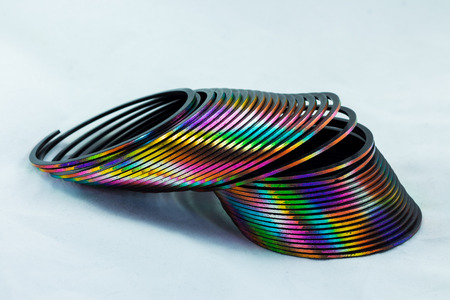 One colorful slinky toy with it different colors.
