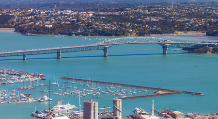 Blue clear water under Auckland harbour bridge,