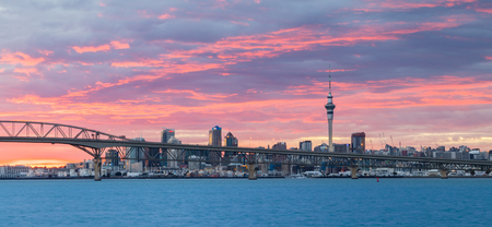 Bridge  over the City of Auckland with a wonderful clouded morning sky.