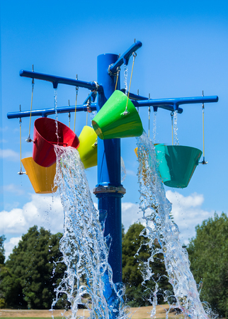 Color bucks of cool water at a fun water park. Stock Photo
