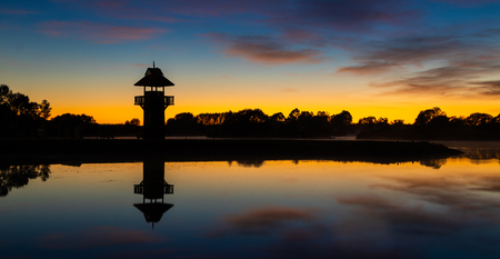 Still waters at Henley Lake Park, Masterton, New Zealand at dawn.