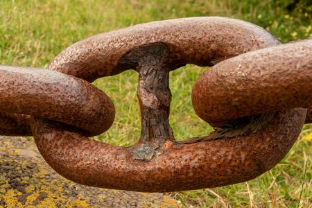 Old large rusted link chain. Stock Photo