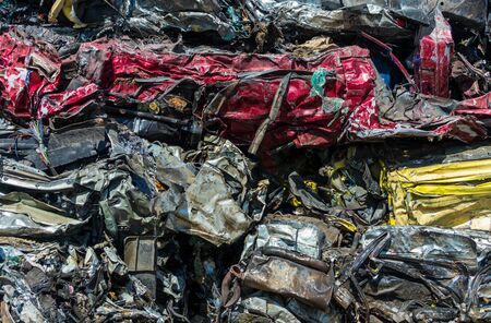 Stack of crush cars waiting to be recycled. Stock Photo