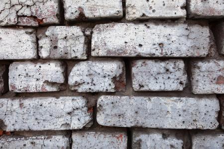 damaged: damaged brick wall background Stock Photo