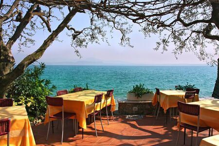 sirmione: An outdoor restaurant with beautiful view on Lake Garda in Sirmione, Italy. Editorial
