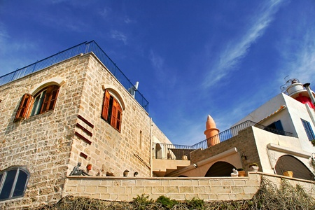 yaffo: Old stone house under the blue sky with white clouds in Yafo, Israel.