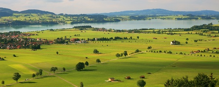 Aerial panoramic view on green fiekds and meadows of Germany.