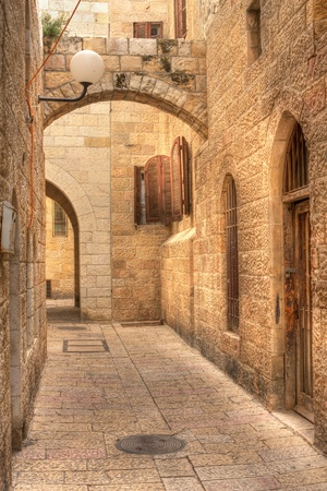 and israel: Vertical oriented image of old street in historic part of Jerusalem, Israel.