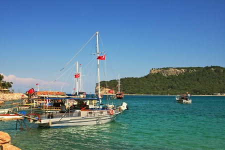 View on small bay with yachts and boats on Mediterranean Sea in Kemer, Turkey.