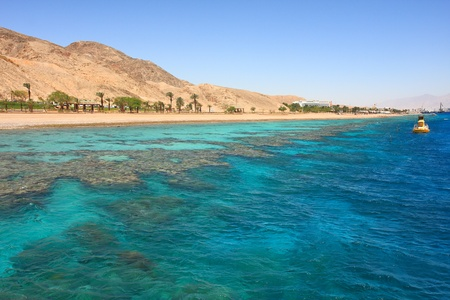 View on red mountains along beautiful shoreline of Red Sea in Eilat, Israel. Stock Photo
