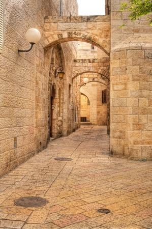 Vertical oriented image of old street in historic part of Jerusalem, Israel.