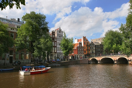 amstel: View on Amstel river (city canal) and historic houses in Amsterdam, Netherlands (Holland).