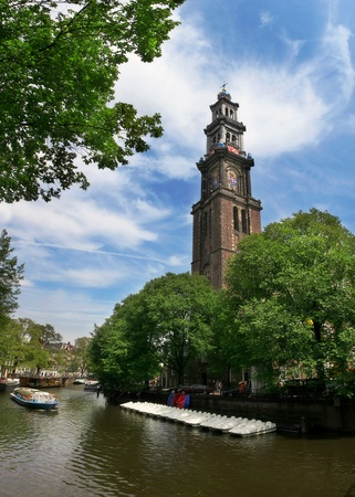 amstel river: View on Amstel river and Westerkerk church (western church) in Amsterdam, Netherlands. Stock Photo
