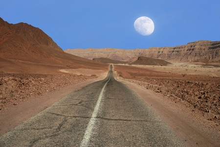 View on narrow road running through the mountains of Arava desert in Israel. photo