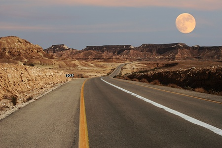 View on narrow highway running through Ramon Crater at Negev desert in Israel. photo