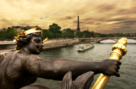 alexander: View on Seine river and Eiffel Tower through the sculpture on famous Alexander III bridge in Paris, France. Stock Photo