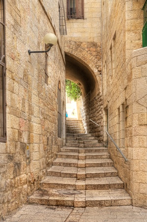 jewish houses: Vertical oriented image of old street in historic part of Jerusalem, Israel.