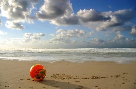 east coast: Summer game ball on the beach under the cloudy sky on Mediterranean Sea in Tel Aviv, Israel.