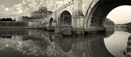 Panoramic view on famous Saint Angel Castle and bridge over the Tiber river in Rome, Italy (sepia toned). Stock Photo