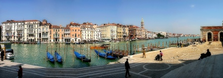 Panoramic view on multicolored buildings along famous Grand Canal in Venice, Italy.