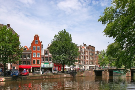 Streets, houses and city canal in Amsterdam, Netherlands. photo