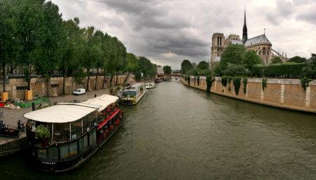 View on Seine river and famous Notre Dame de Paris cathedral in Paris, France.