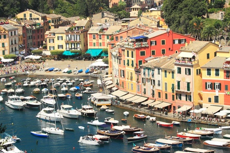 View on small bay with boats and yachts and multicolored houses of Portofino - small town on Ligurian sea in northern Italy. Stock Photo - 10820480