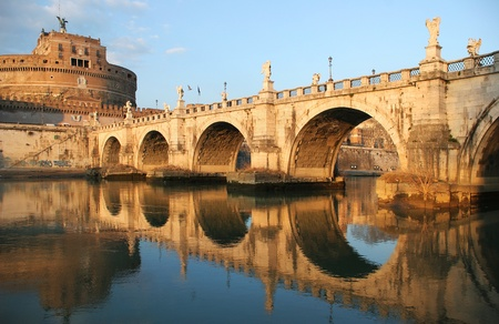 rome italy: View on famous Saint Angel castle and bridge over the Tiber river in Rome, Italy.