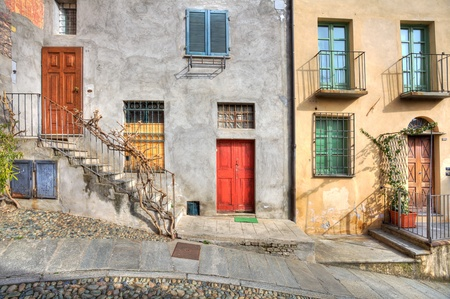 saluzzo: Wooden multicolored doors in the old house at the town of Saluzzo, northern Italy.