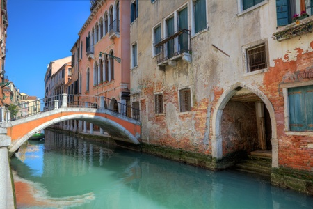 venice bridge: Small bridge over canal and multicolored old houses in Venice, Italy. Stock Photo