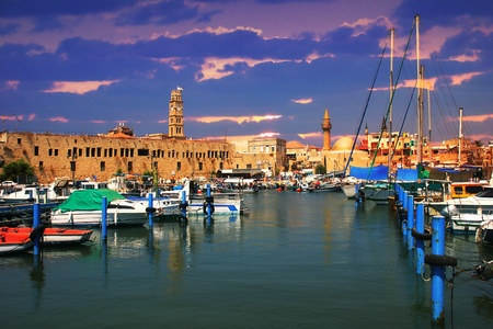 tourist site: View on marina with yachts and ancient walls of harbor in Acre, Israel.