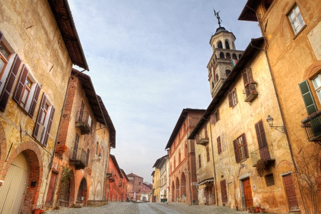 Paved street among old historic houses in town of Saluzzo, northern Italy. Stock Photo - 11860972
