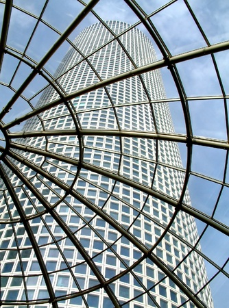Modern glass roof in Azrieli shopping center with view on skyscraper in Tel Aviv, Israel.