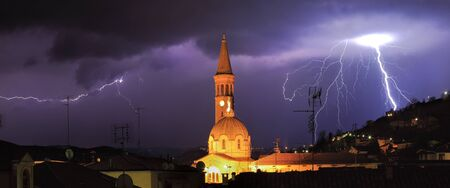 Panoramic view on lightning over Alba and surrounding hills during thunderstorm in northern Italy. photo