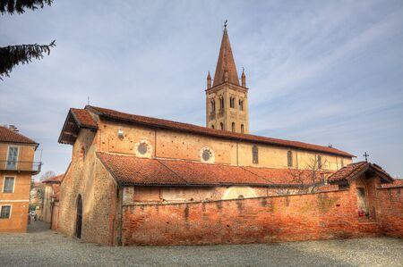 paved: Old cathedral exterior view in town of Saluzzo, northern Italy. Stock Photo