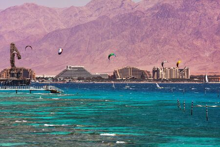 View on coastline with hotels, mountains and bay of Eilat located on Red Sea in Israel.