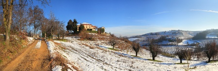 Panoramic view on snowy hills and vineyards of Piedmont, northern Italy. photo