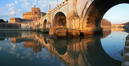 Panoramic view on famous Saint Angel castle and bridge over the Tiber river in Rome, Italy.