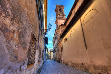 saluzzo: Small street among old medieval houses in Saluzzo, Italy. Stock Photo