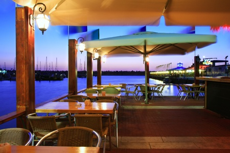 mid morning: Outdoor restaurant at sunset on Marina in Ashqelon, Israel.