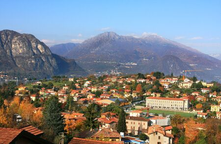 lake como: Aerial view on small town among the mountains on Lake Como in Italy.