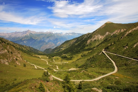 unpaved road: Unpaved road among hills and mountains in northern Italy.