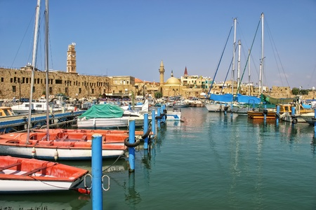 akko: Yachts and boats at old harbor against ancient walls of historic town of Acre  Akko  in Israel