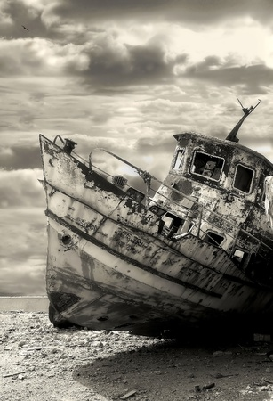 Vertical oriented image of old rusty ship in harbor of Yafo  Jaffa , Israel  sepia toned   photo