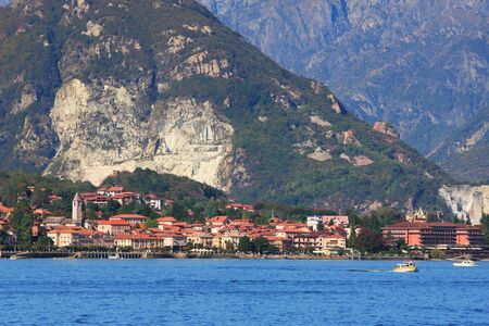 maggiore: Small town on lake Maggiore and mountains on the background in Northern Italy  Stock Photo