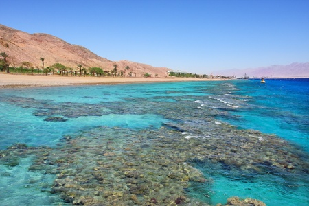 Horizontal oriented image of beautiful view on Red Sea and shoreline at popular touristic resort of Eilat, Israel  photo
