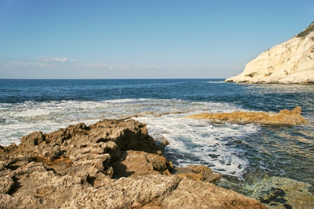 nature reserves of israel: View on coastal rocks and chalk cliff on the shores of Mediterranean sea at Rosh HaNikra reserve in Israel  Stock Photo